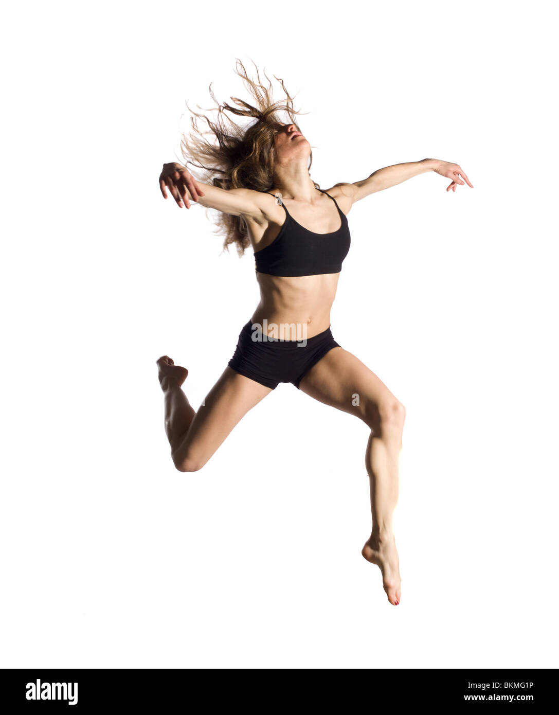 Bellissima giovane ballerina professionista jumping Immagini Stock