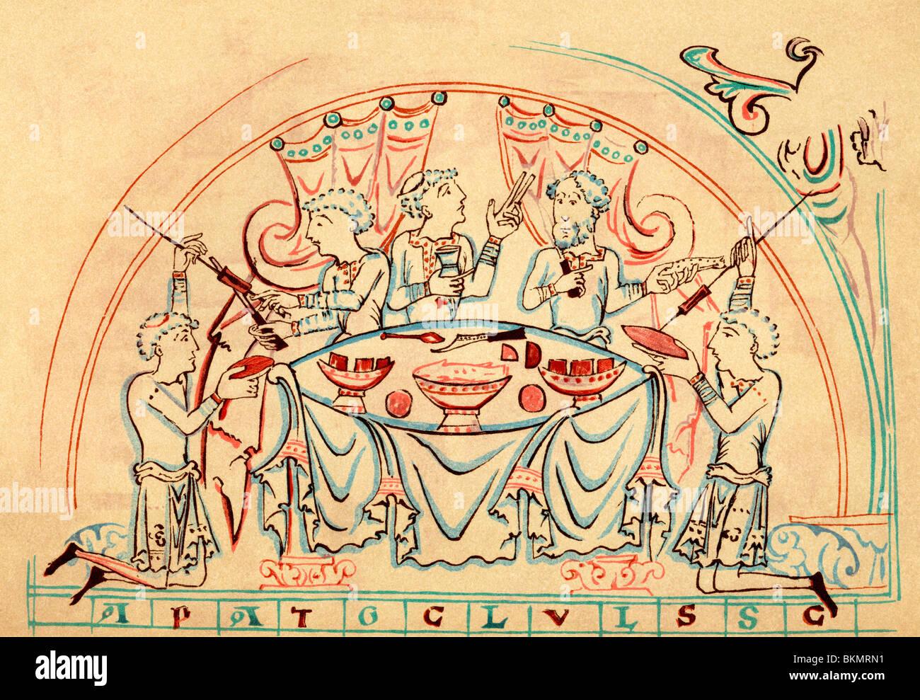 Un banchetto medioevale. Immagini Stock
