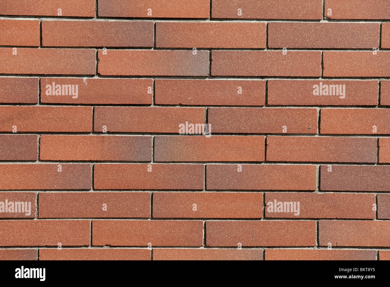 Rosso di un muro di mattoni per lo sfondo Immagini Stock
