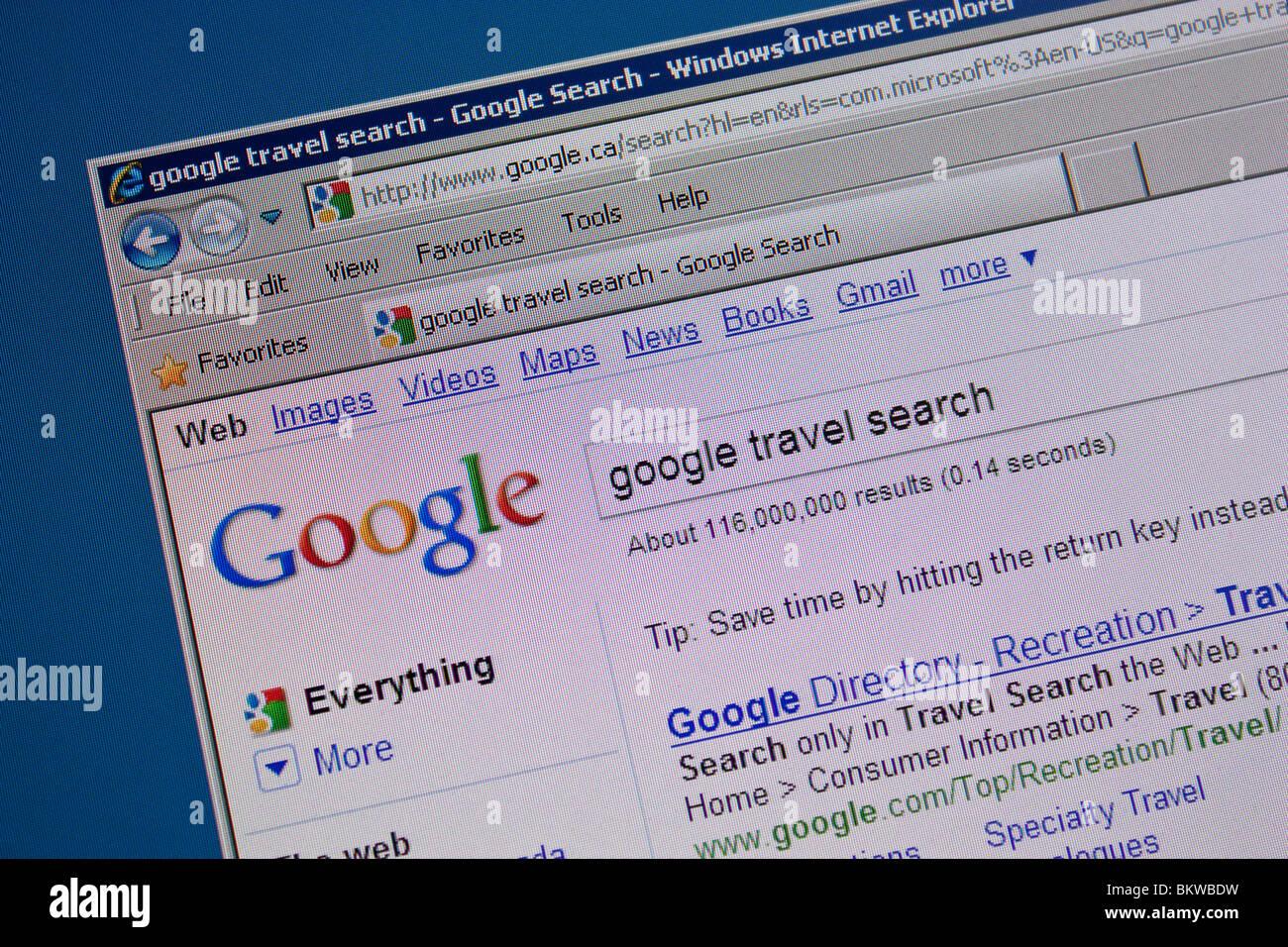 Google ricerca di viaggi dello schermo del computer Immagini Stock