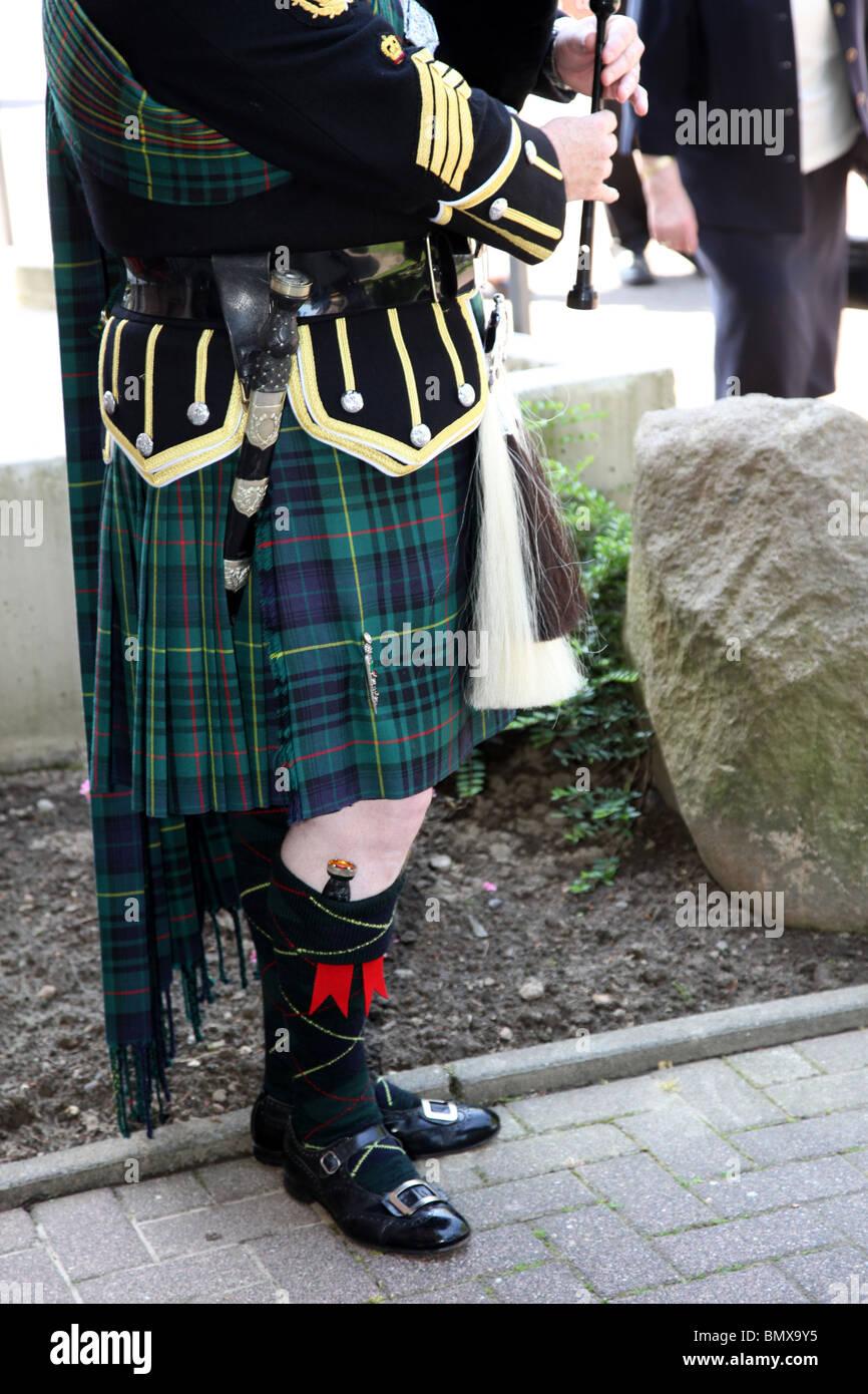 Cornamusa scozzese piper con cornamuse Foto Stock