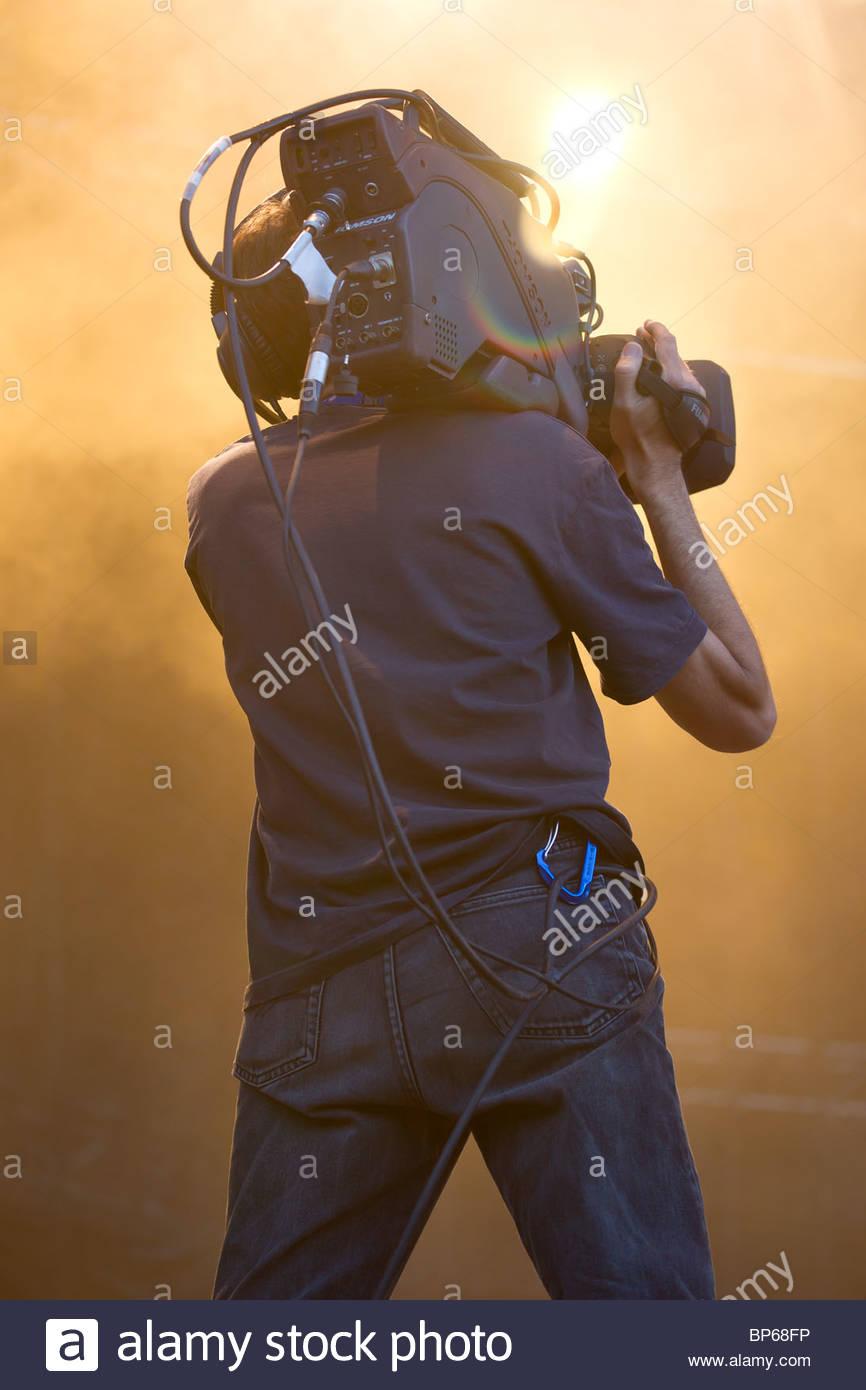 Cameraman professionale al lavoro Immagini Stock