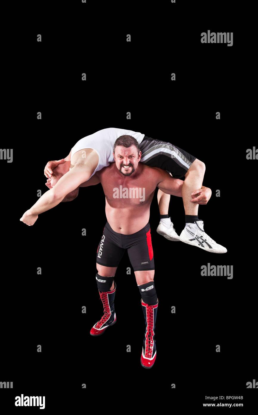 Il lottatore con uomo a spallamenti Immagini Stock