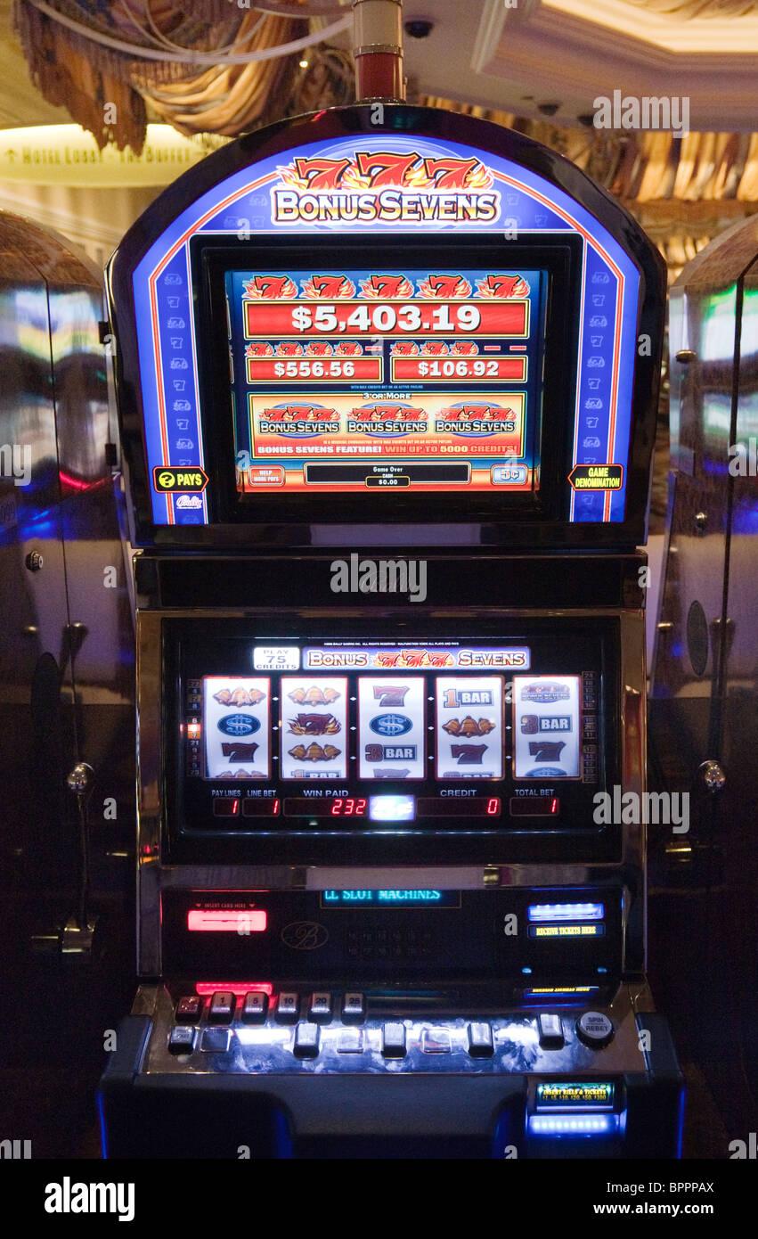 Bonus di Gioco d'azzardo Sevens slot machine, Las Vegas, Nevada USA Foto Stock
