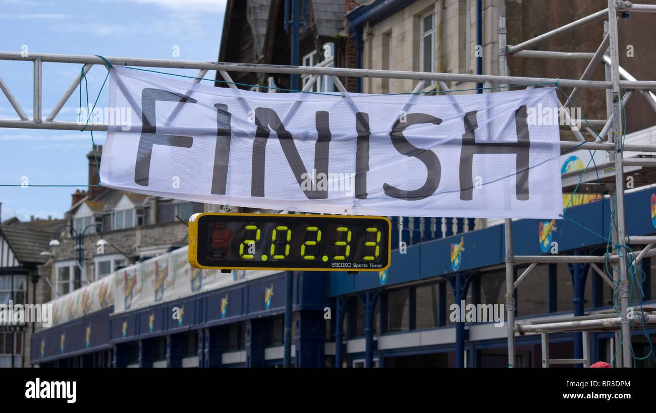 La linea di finitura del Swanage mezza maratona Immagini Stock