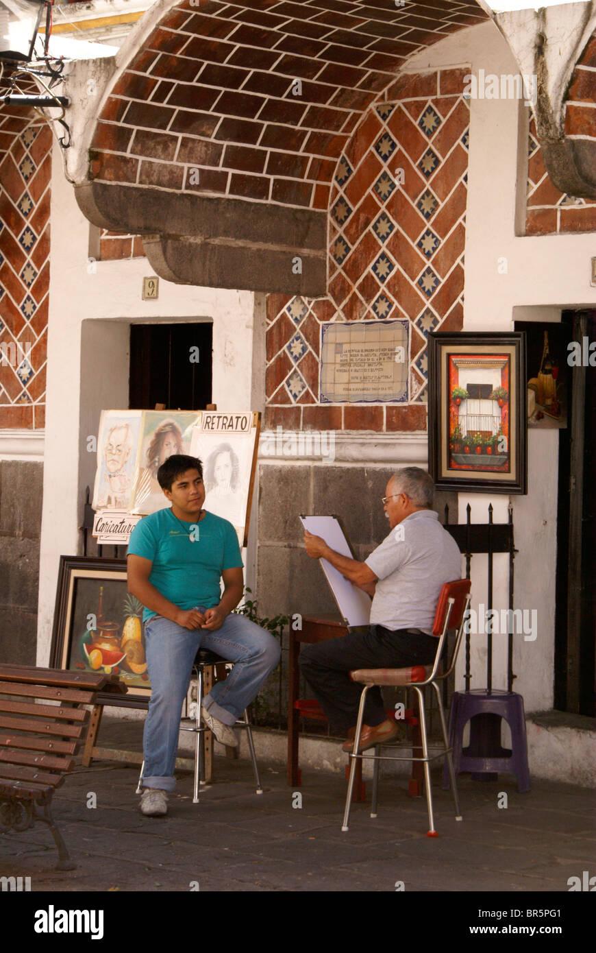 Artista il disegno di un giovane di ritratto, Barrio del artista o artista trimestre nella città di Puebla, Immagini Stock