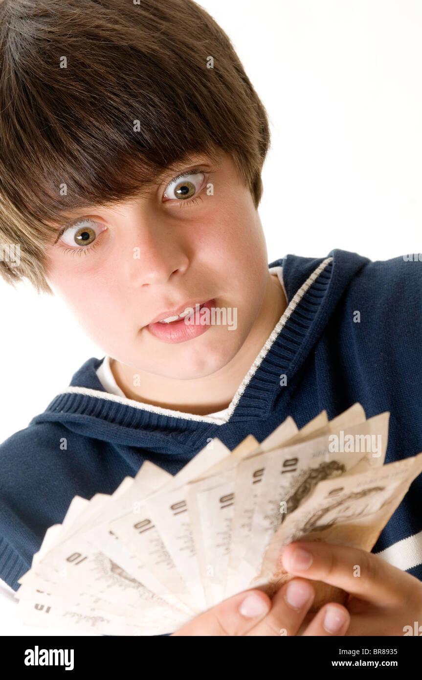 Pocket Money troppo i carichi di denaro contante ricchezza genitori ricchi genitore imbarazzo kid kids bambini adolescente Immagini Stock