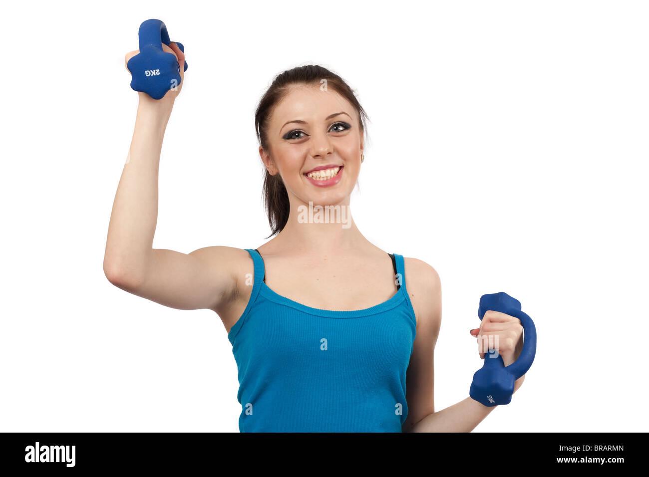 Attraente giovane donna fare allenamento con i pesi isolato su bianco Immagini Stock