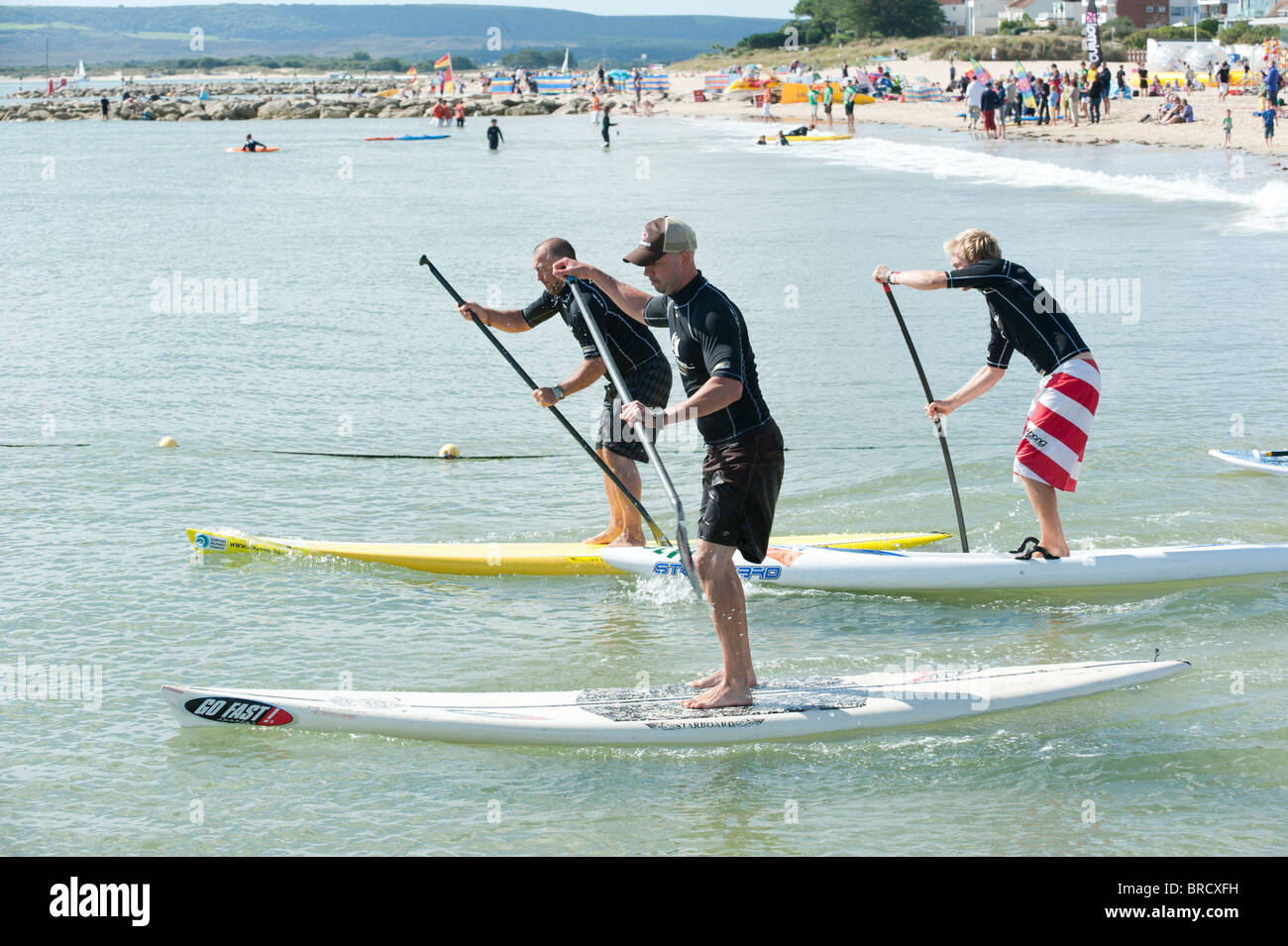 Stand up paddleboard gara, Windfest 2010 alle barene spiaggia in Poole Immagini Stock