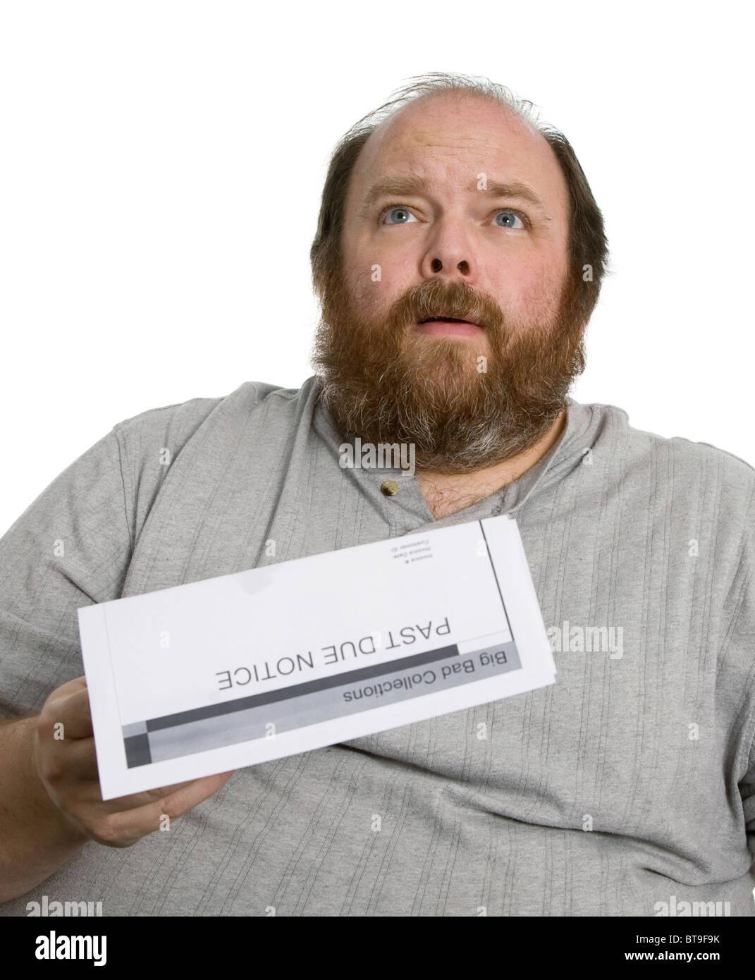Uomo con un passato dovuto preavviso e guardando molto preoccupato Immagini Stock