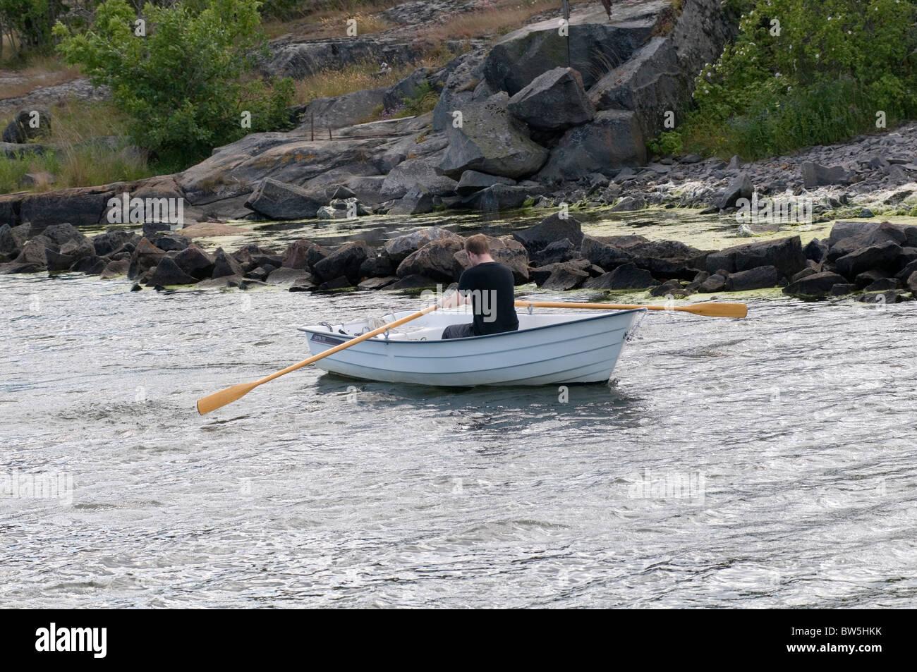 Barca a remi imbarcazioni a remi vogatore uomo Minerali metalliferi Minerali di piccole piastre paddle float galleggiabilità Immagini Stock