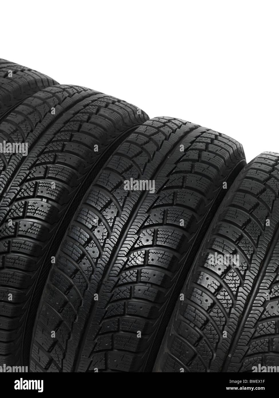 Set di quattro pneumatici invernali isolati su sfondo bianco Immagini Stock