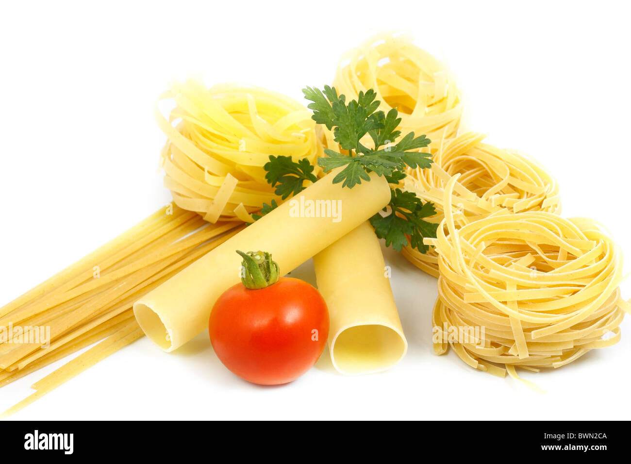 Pasta con verdi e pomodoro Immagini Stock
