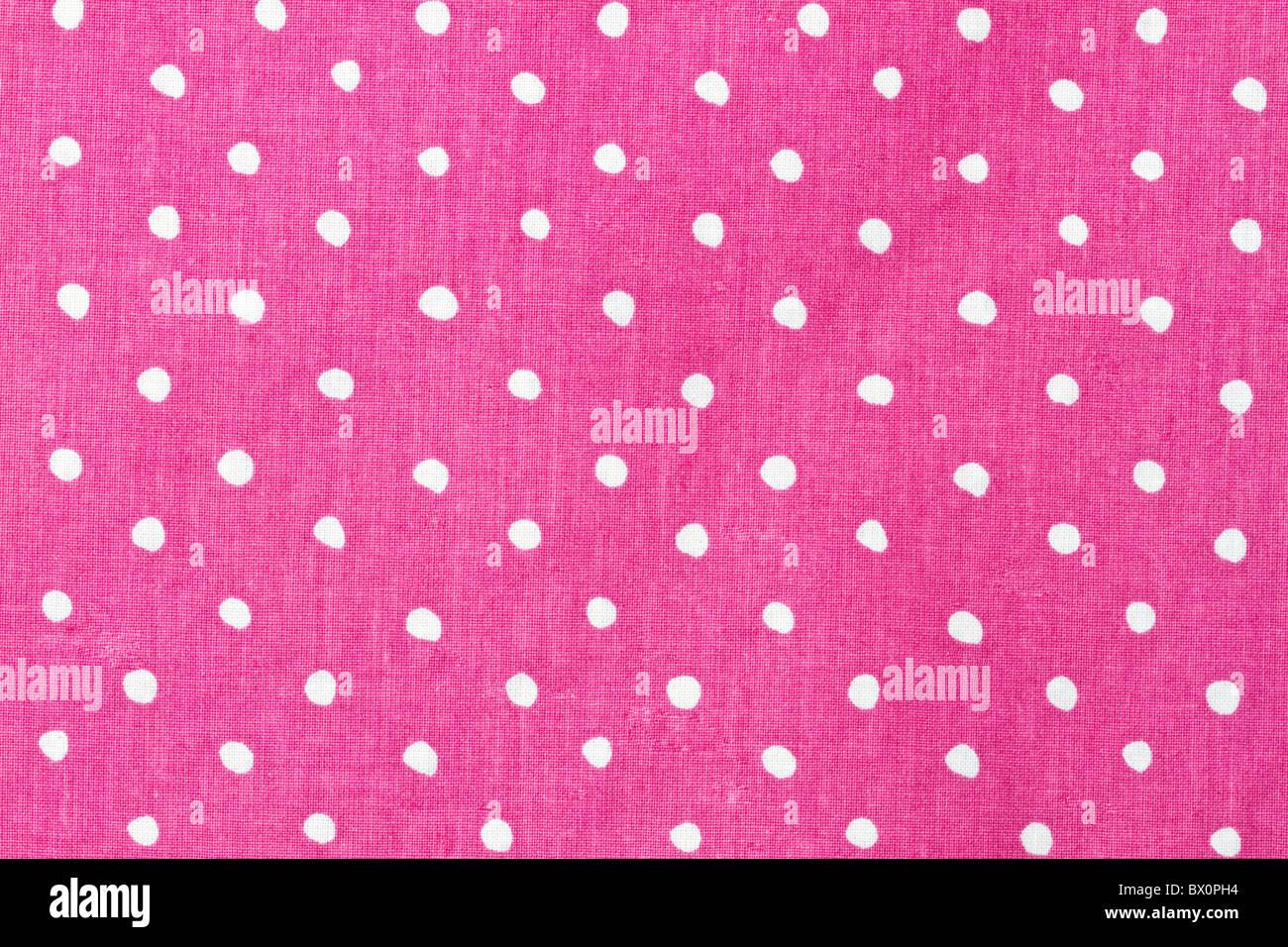 Rosa E Puntini Bianchi Sullo Sfondo Di Tessuto Foto Immagine Stock