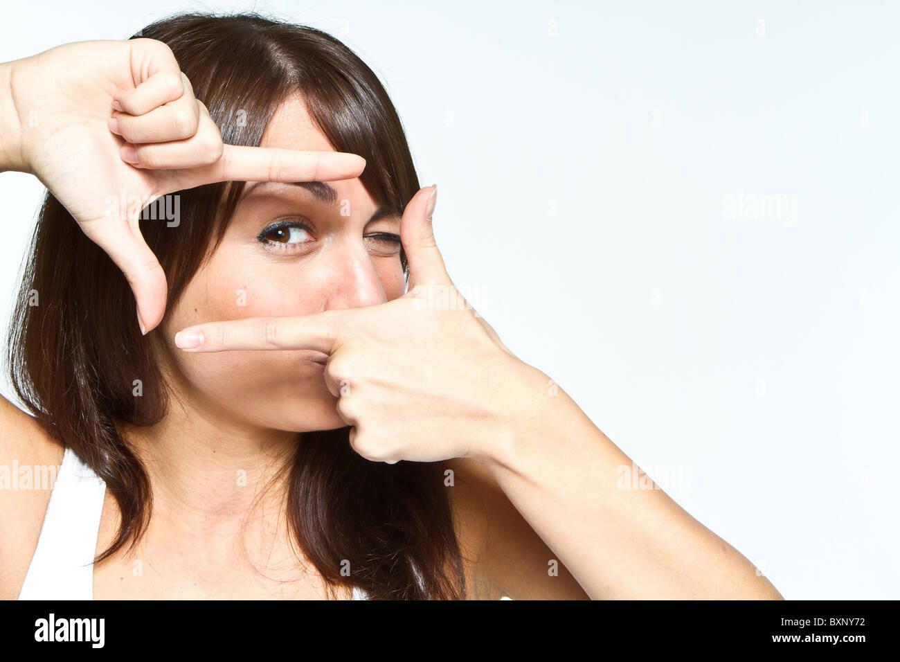 Donna con segno di telaio Immagini Stock
