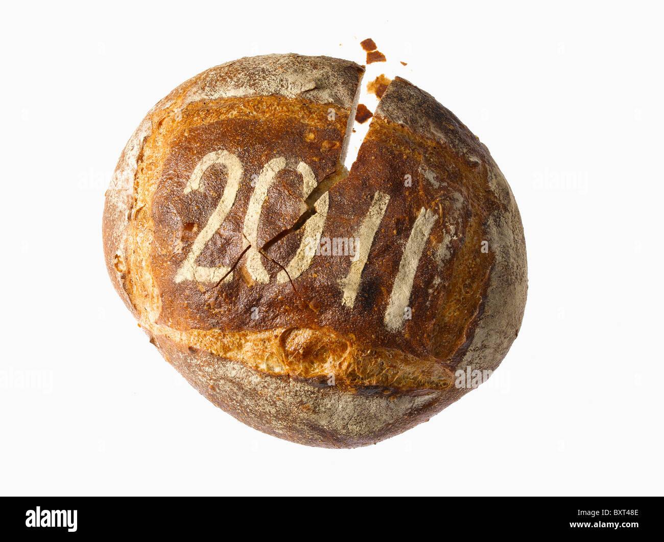 Pagnotta di pane spolverata con l'anno 2011 Immagini Stock