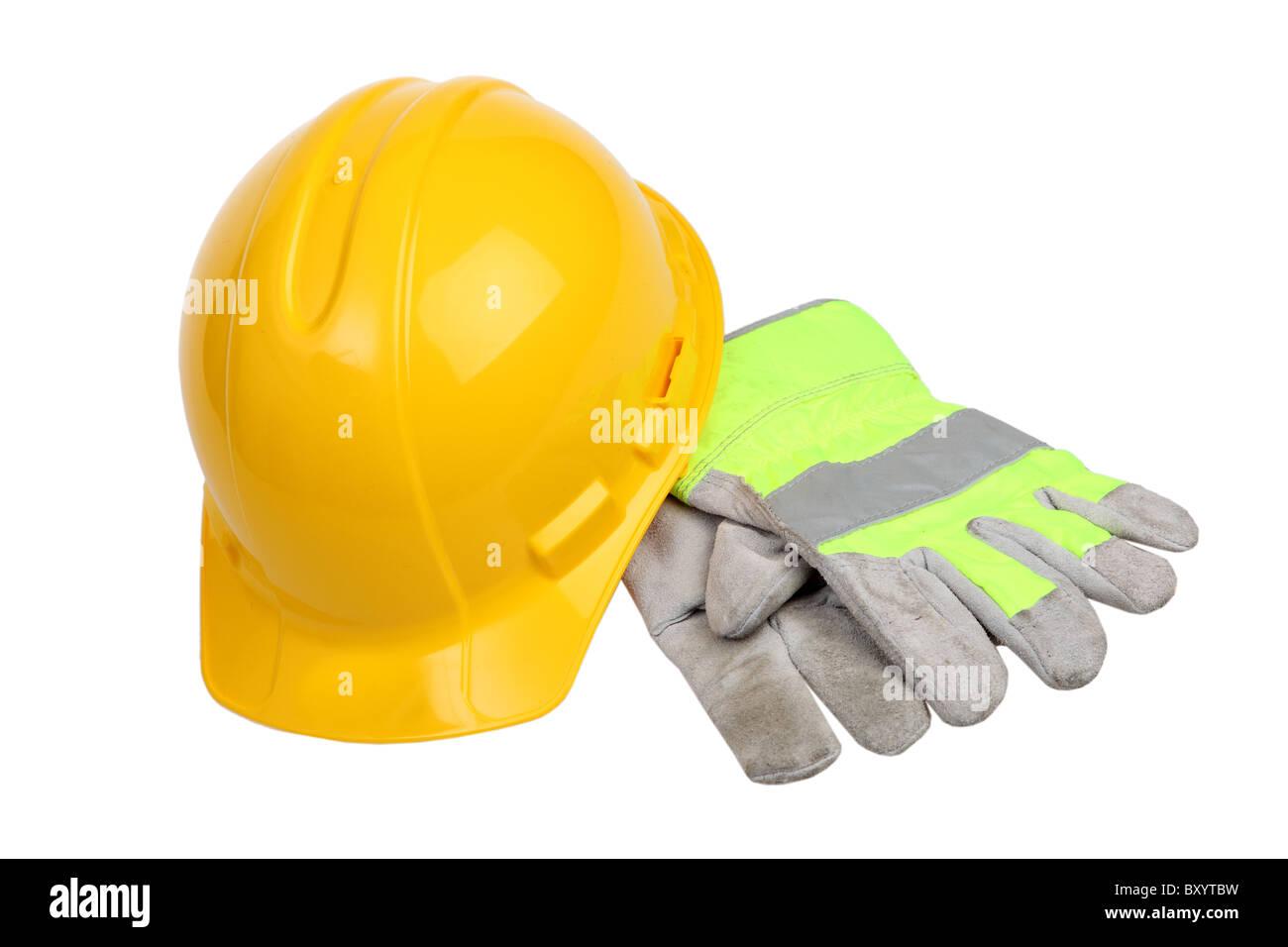 Costruzione di elmetto e guanti da lavoro su sfondo bianco Immagini Stock