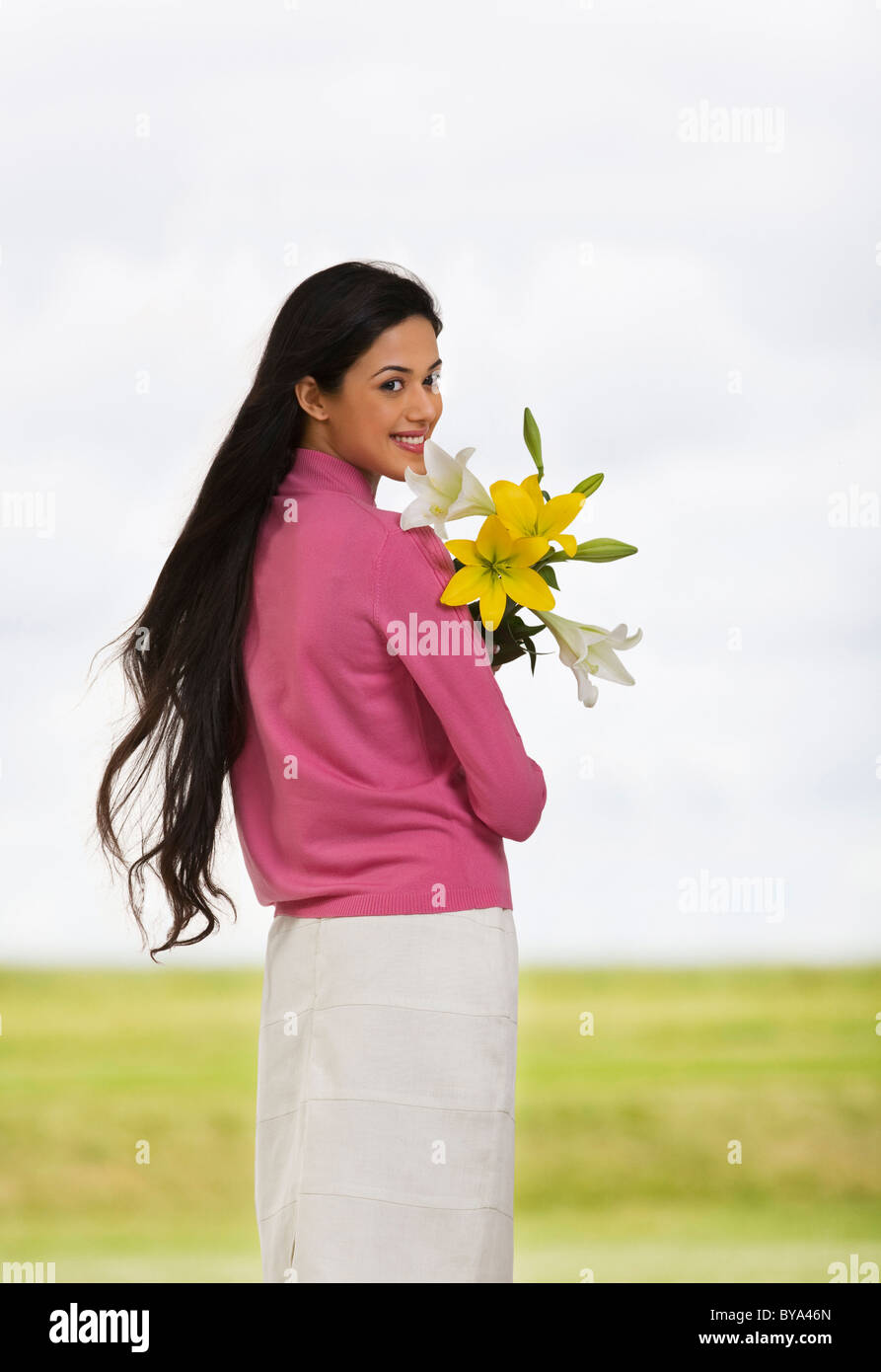 Ragazza con i fiori Immagini Stock
