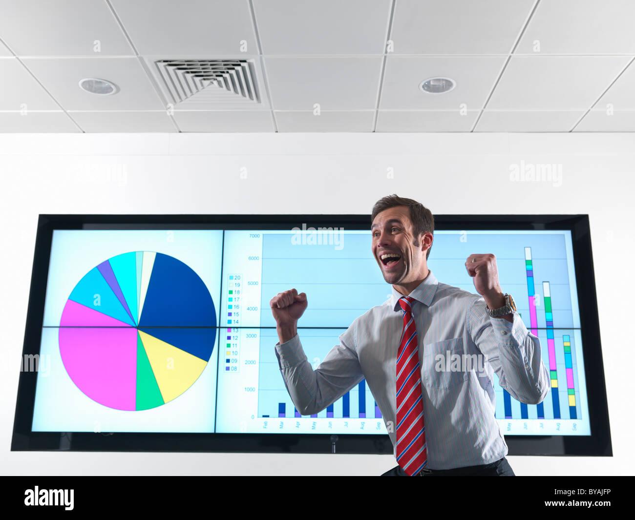 Imprenditore di successo con grafico Immagini Stock