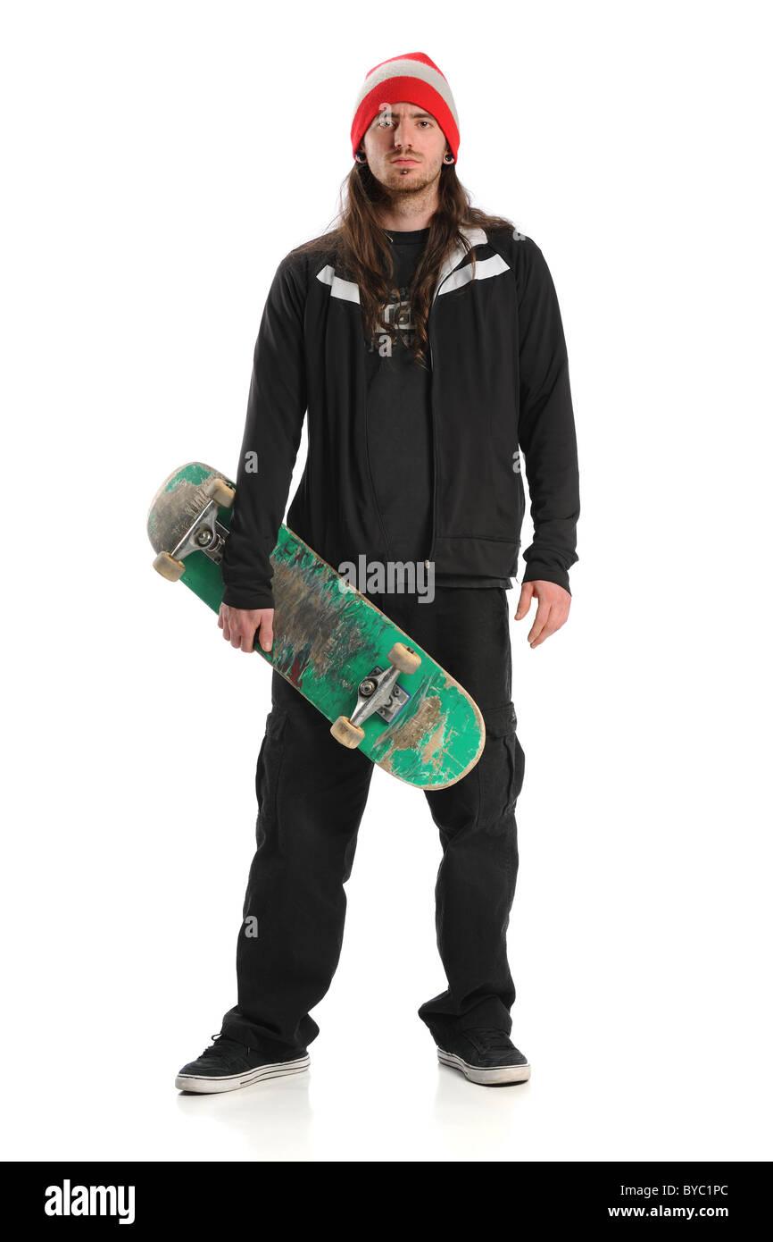 Ritratto del guidatore di skateboard in piedi isolato su sfondo bianco Immagini Stock