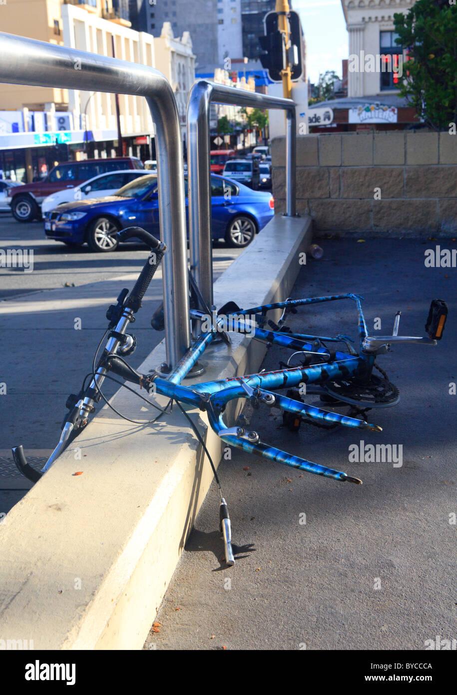 Noleggio bloccato al recinto con ruote rubato Immagini Stock
