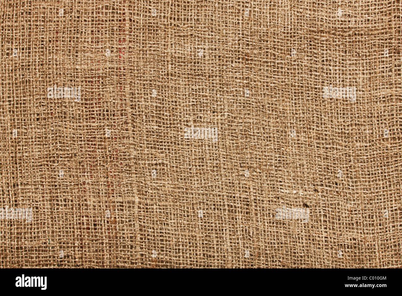 Immagine di sfondo con grossolana del tessuto in tela Immagini Stock
