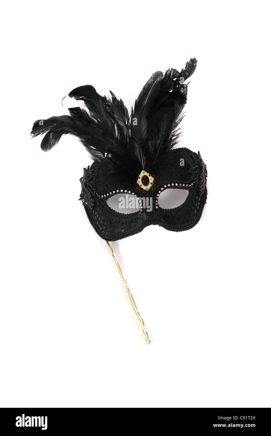 Un carnevale tenuto in mano maschera. Immagini Stock