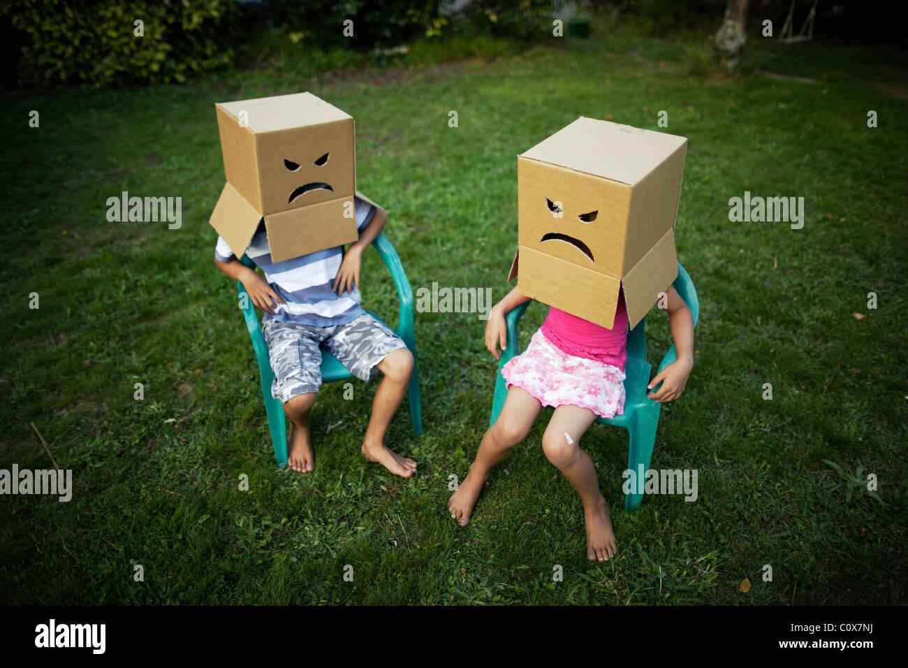Facce arrabbiate Foto Stock