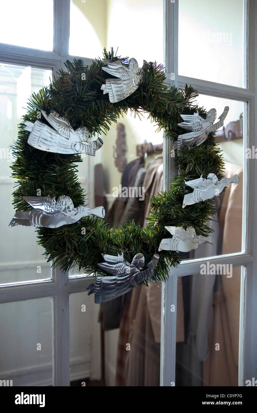 Ghirlanda di Natale con angeli di stagno Immagini Stock