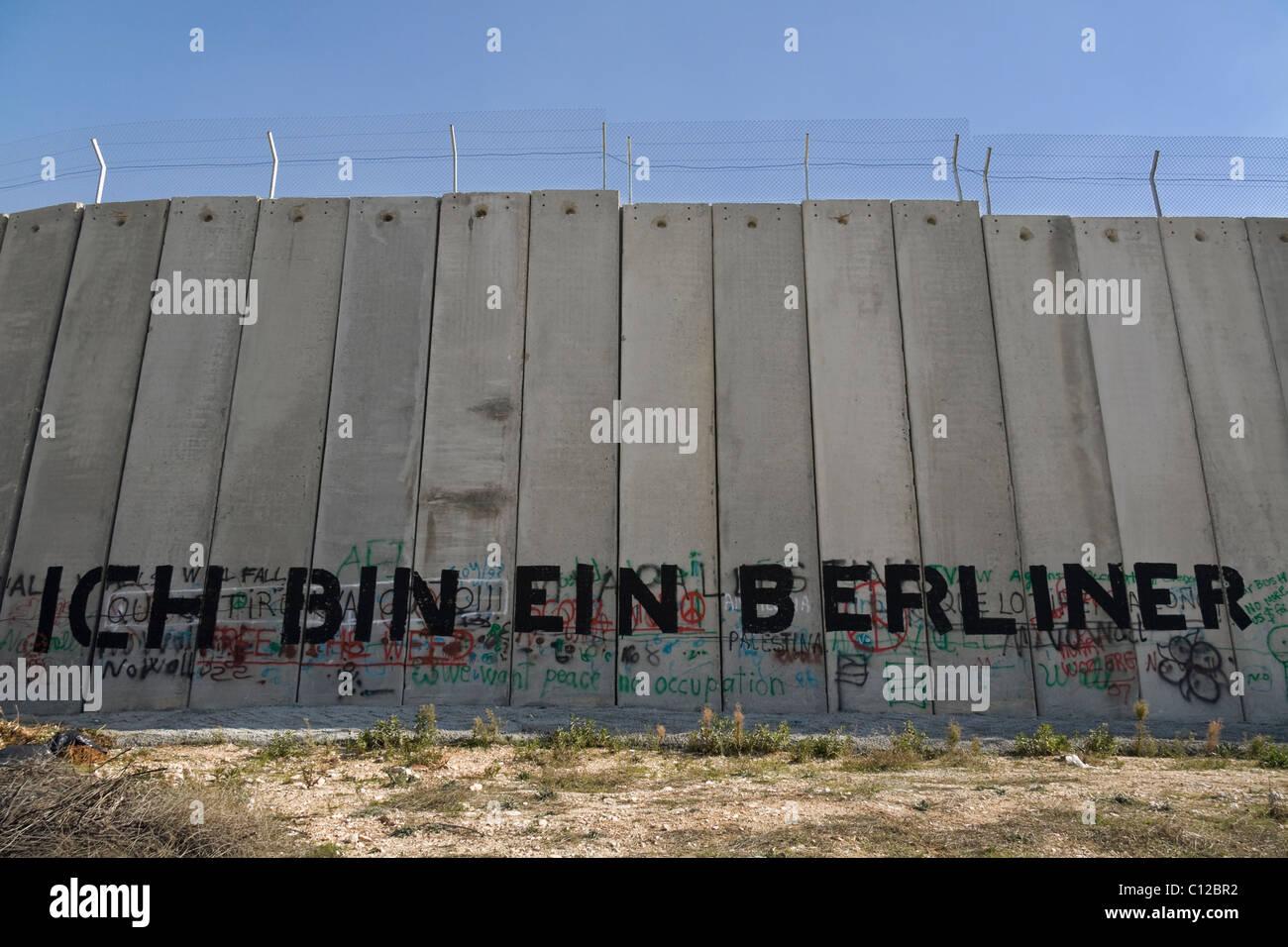 Un graffito sulla parete di separazione, Palestina Immagini Stock