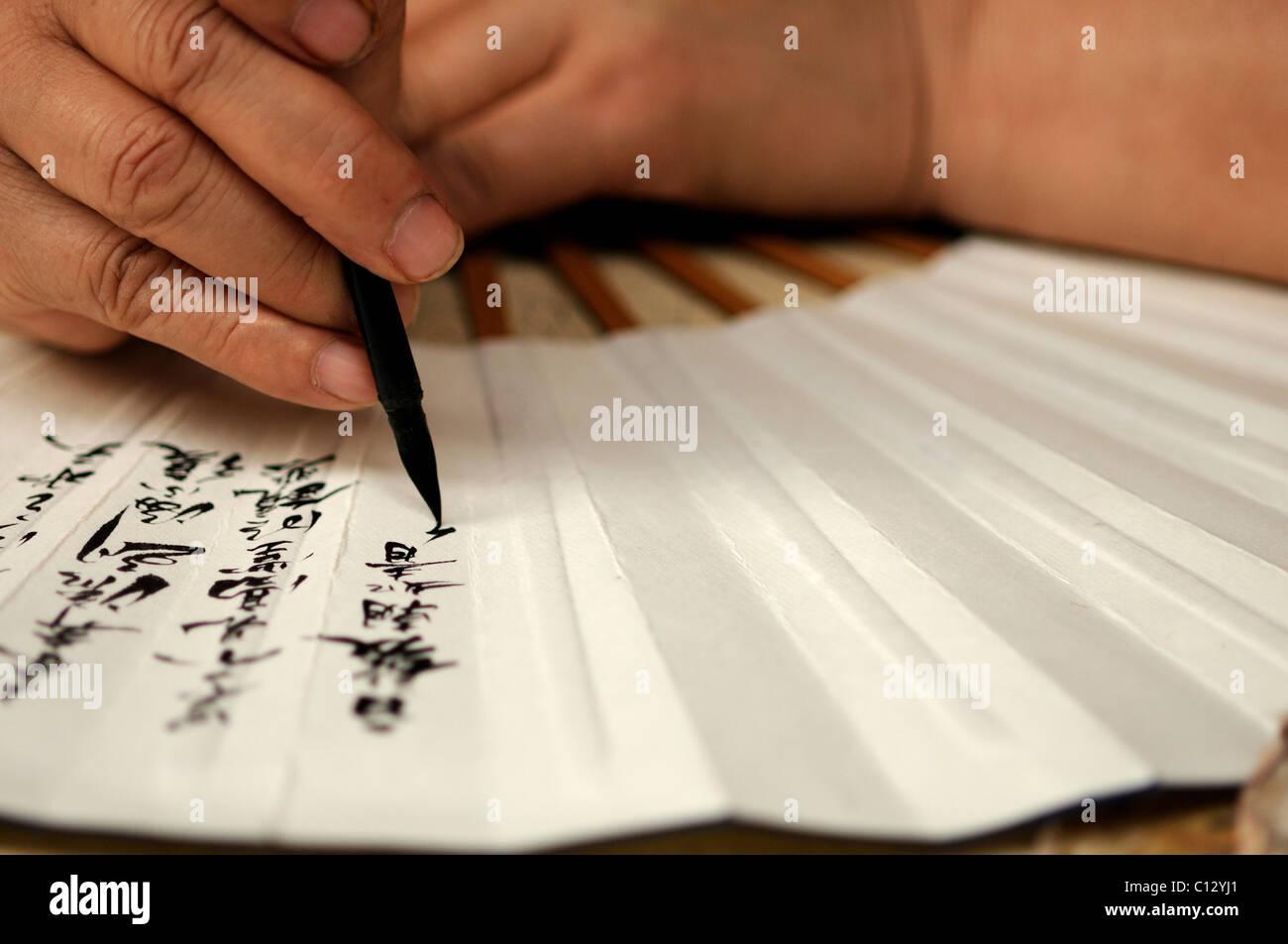 Artigiano ventola di pittura con i caratteri cinesi Immagini Stock