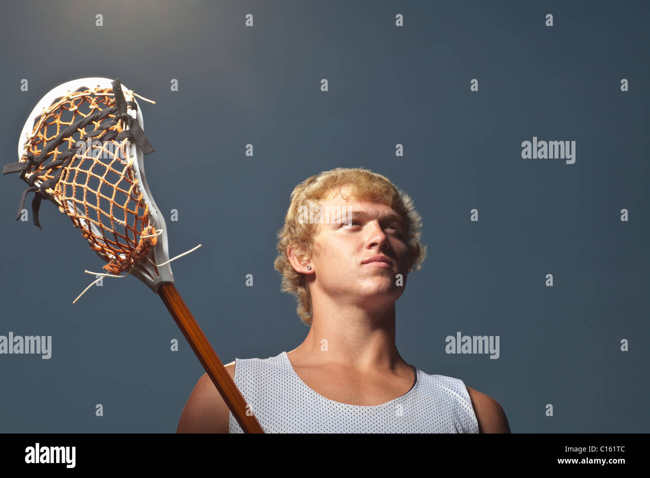 Lacrosse player con lacrosse stick Immagini Stock