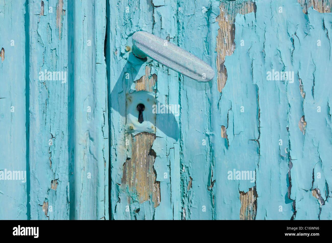 Turquise porta con una manopola dello sportello, Cicladi Grecia, Europa Immagini Stock