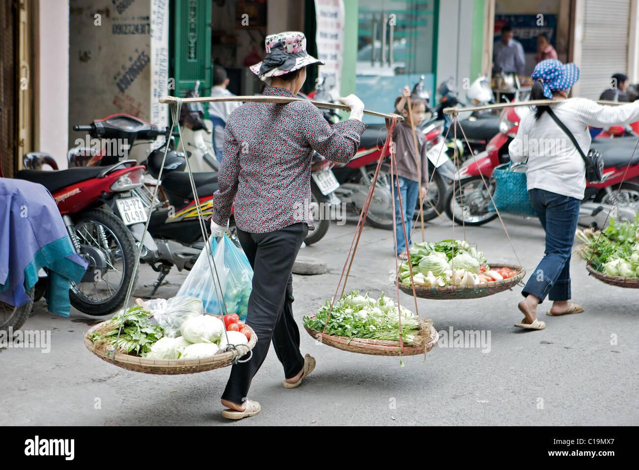 I vettori della forcella per le strade di Hanoi, Vietnam Immagini Stock