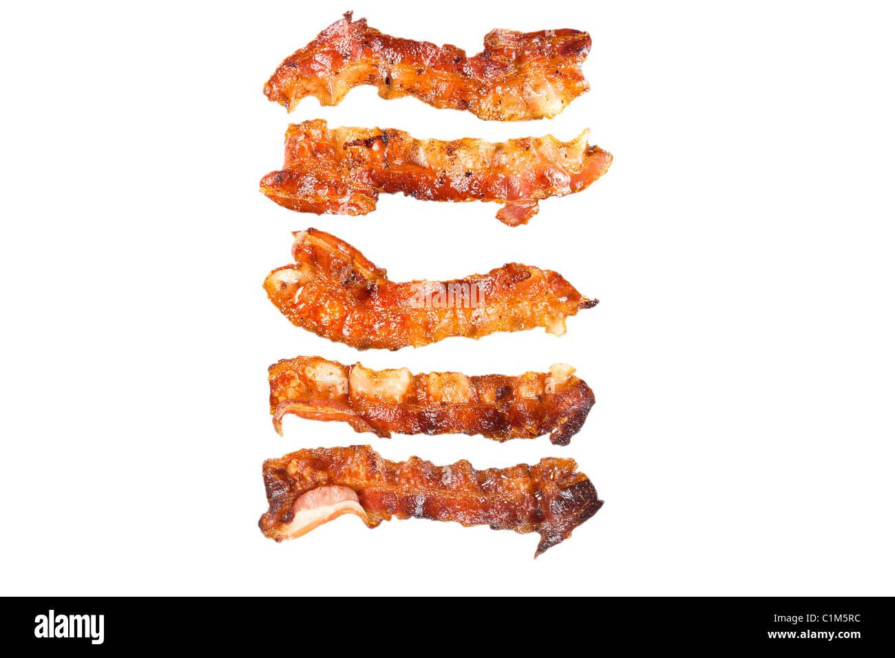 Bacon cotto isolati su sfondo bianco. Charles Lupica Immagini Stock