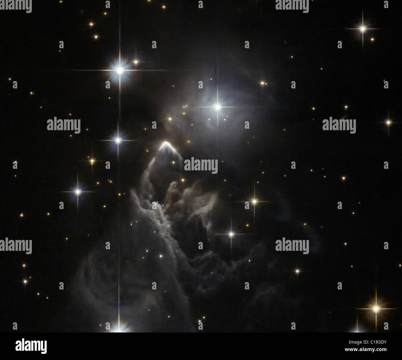 La notte dei ricercatori ancora non sanno che cosa è l'illuminazione IRAS 05437+2502, una piccola e debole Immagini Stock