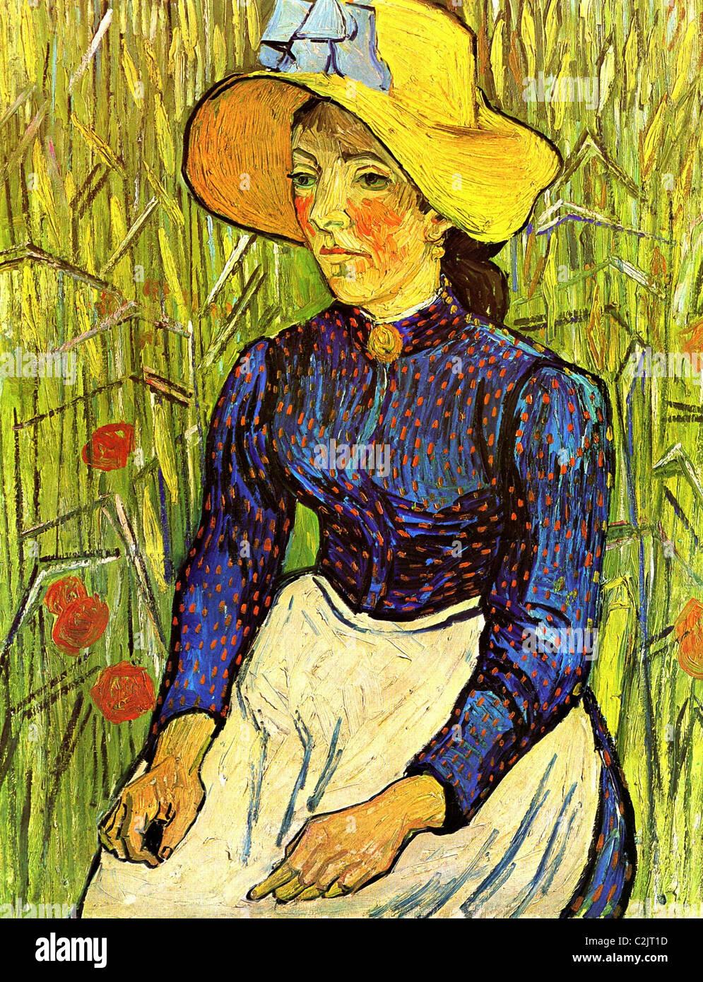Giovane contadino di donna con cappello di paglia in seduta il grano ... 59bd5c7b7efe