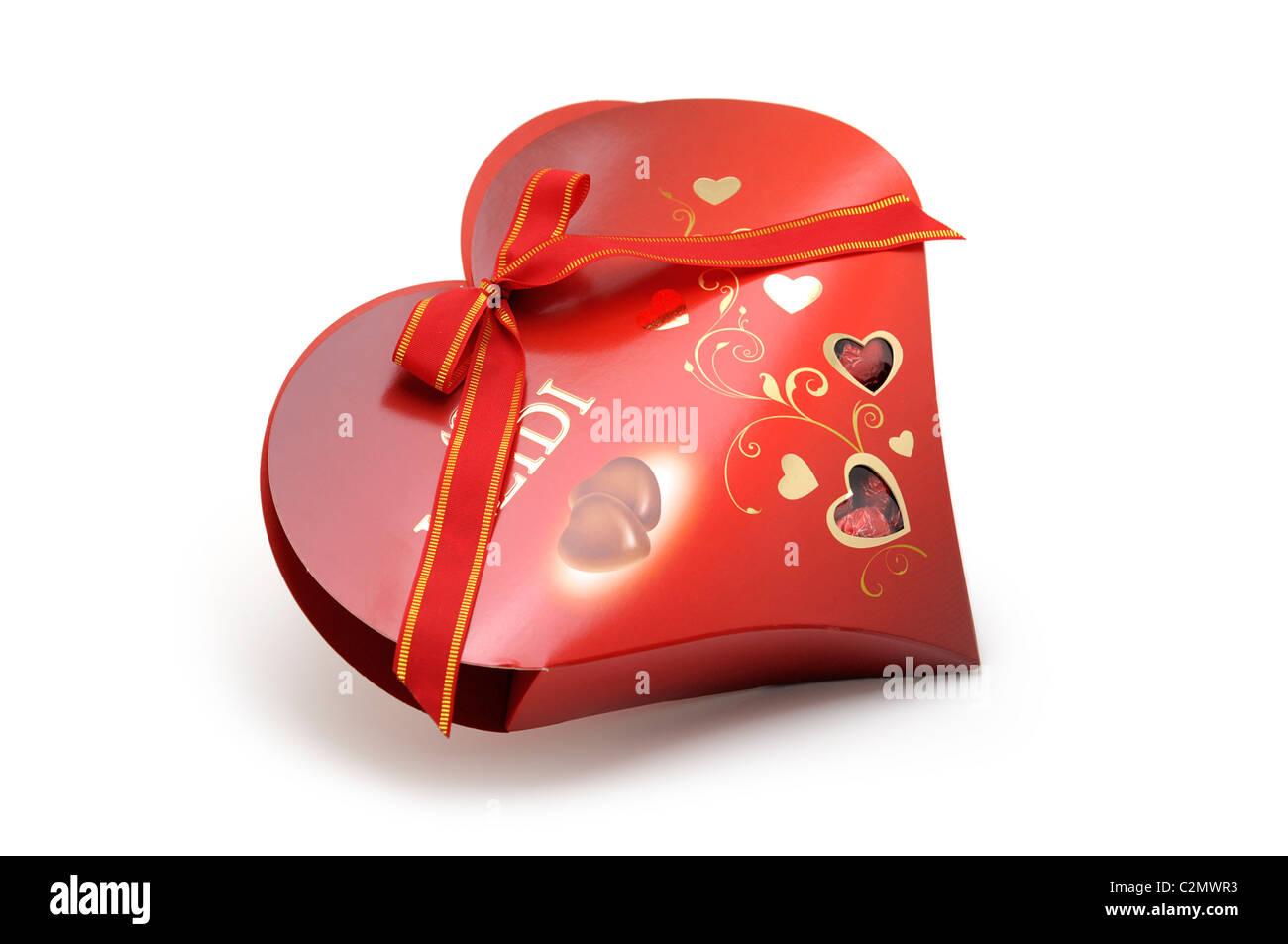Al cioccolato a forma di cuore con scatola di cioccolatini Immagini Stock