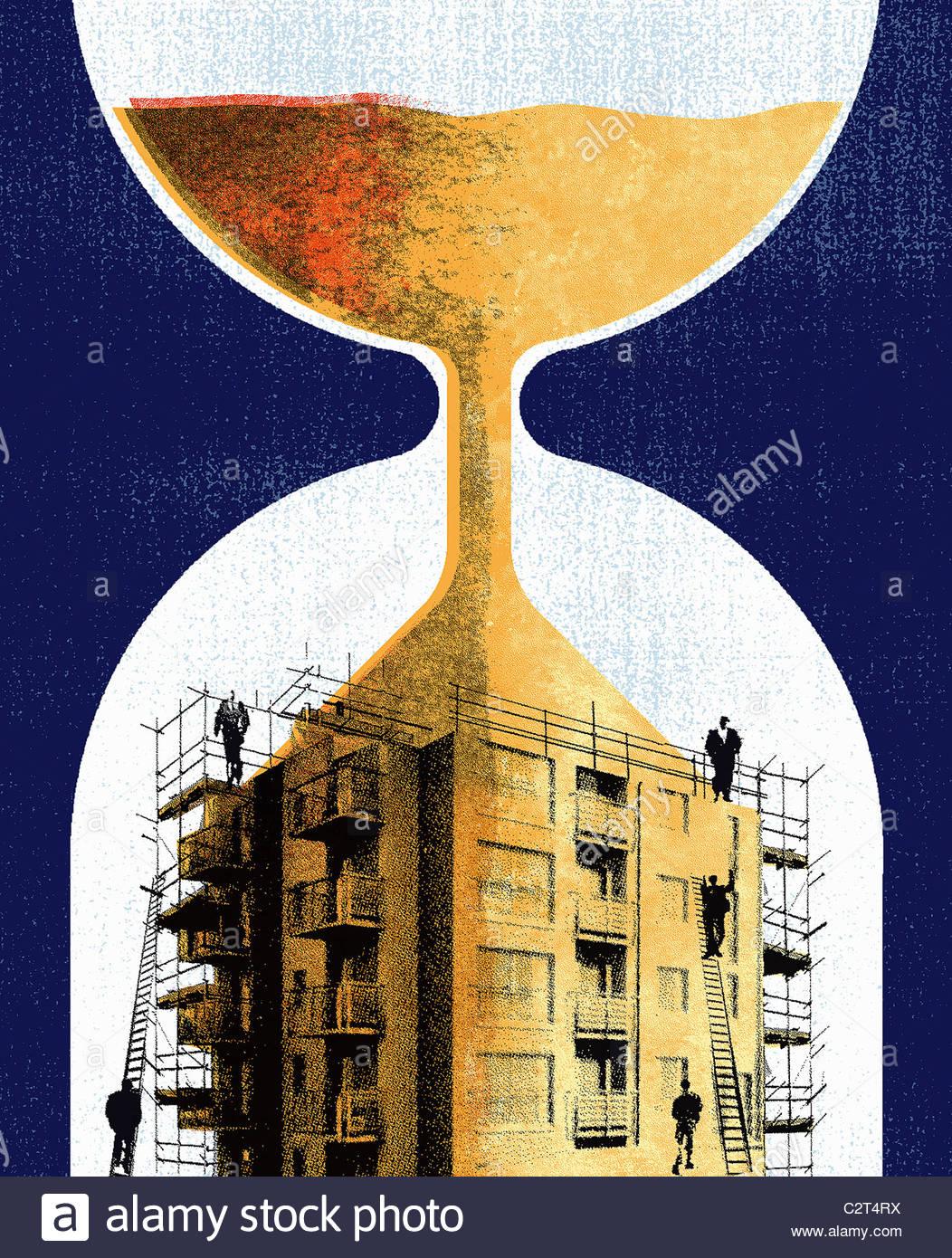 Sabbia di clessidra in esecuzione in edificio con i ponteggi Immagini Stock