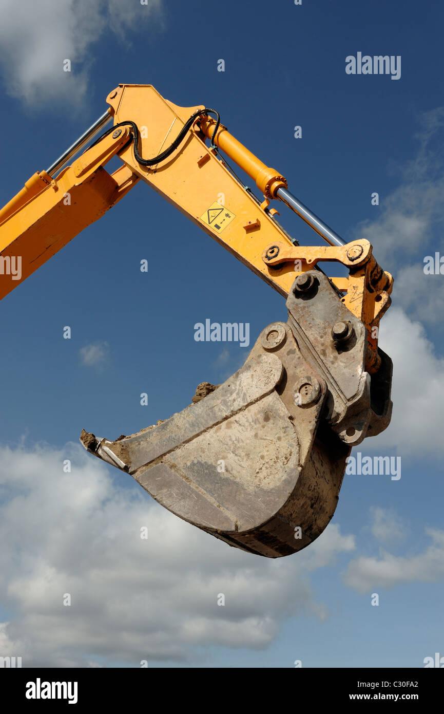 Braccio di scavo e la benna Immagini Stock