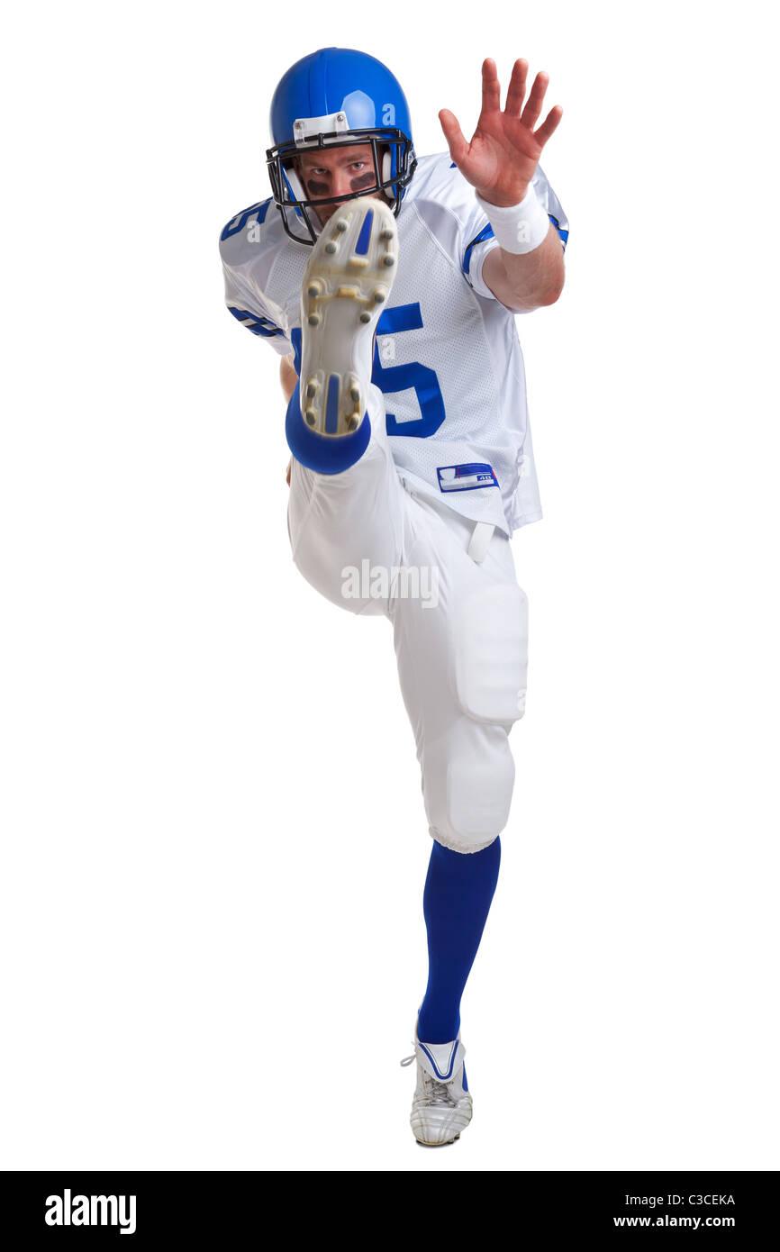 Foto di un giocatore di football americano di calci, isolata su uno sfondo bianco. Immagini Stock