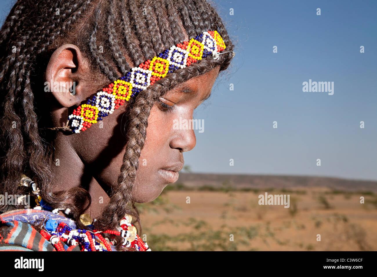 Ragazza di Afar, strada tra Bati e Mille, Etiopia, Africa Immagini Stock
