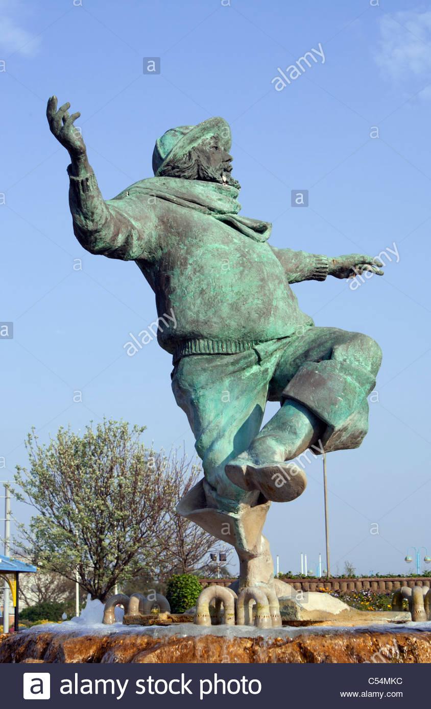 """Skegness. """"Jolly"""" Pescatore statua, preso dalla 'Skegness è così di controventamento poster'. Immagini Stock"""