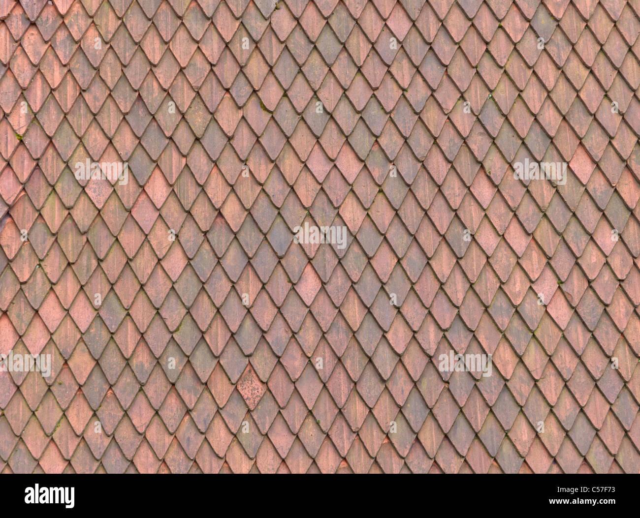 Tegola di materiale di texture di unione edificio medievale Seamless Pattern di sfondo per tetti Immagini Stock