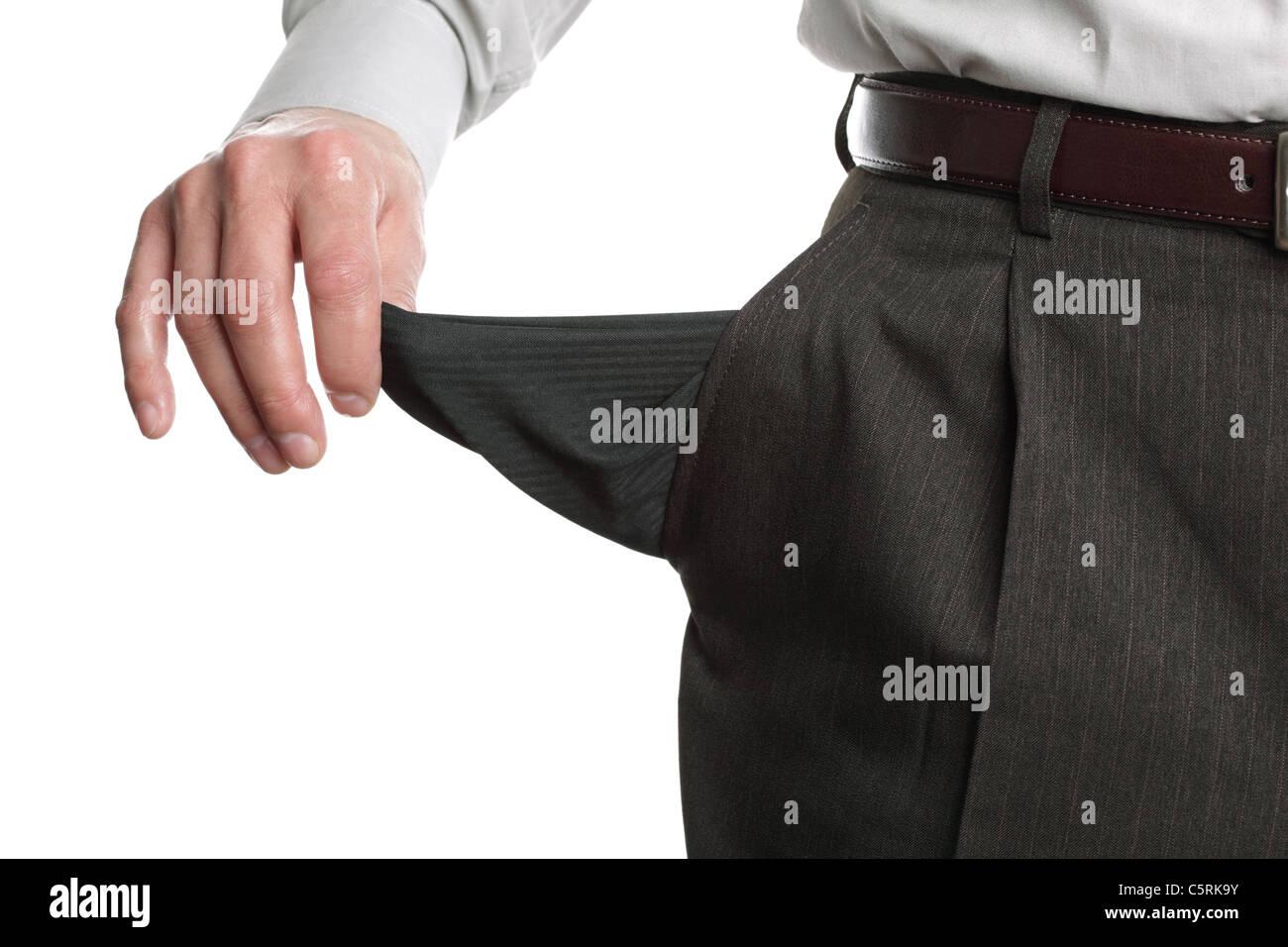 Uomo in fallimento che mostra la tasca vuota Immagini Stock