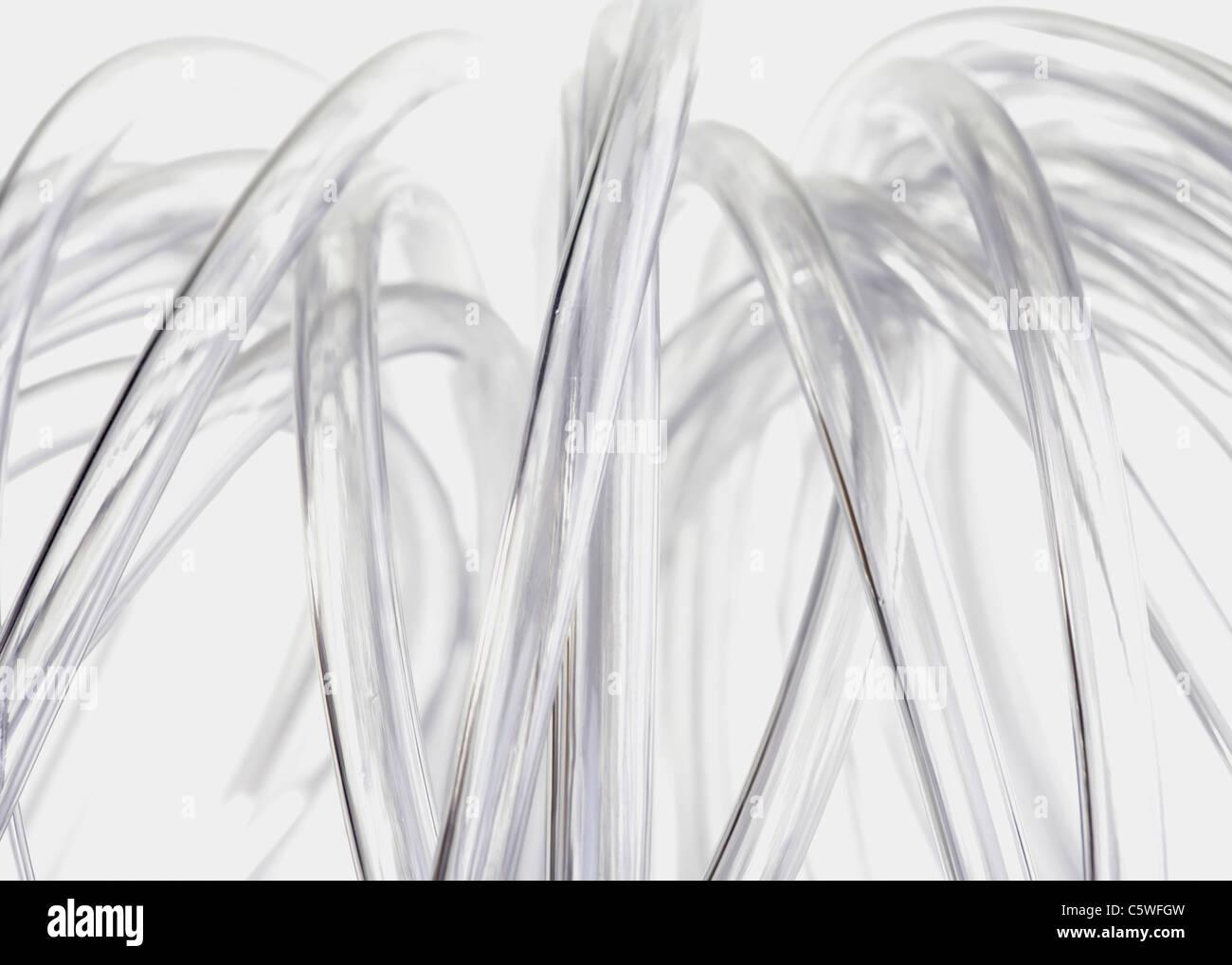 Tubi di plastica contro uno sfondo bianco Immagini Stock