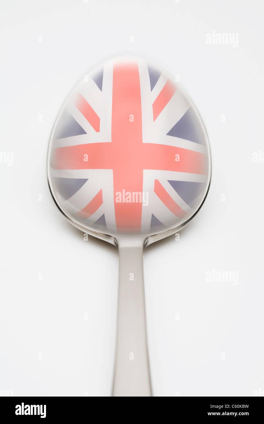 Bandiera britannica riflette in cucchiaio Foto Stock