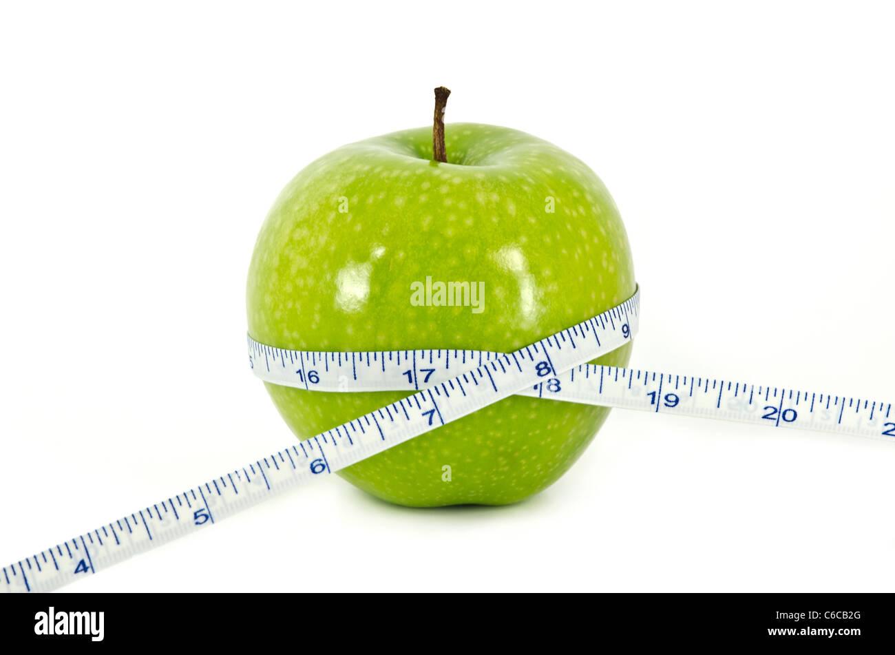 Apple e nastro di misurazione il concetto di Dieta Immagini Stock