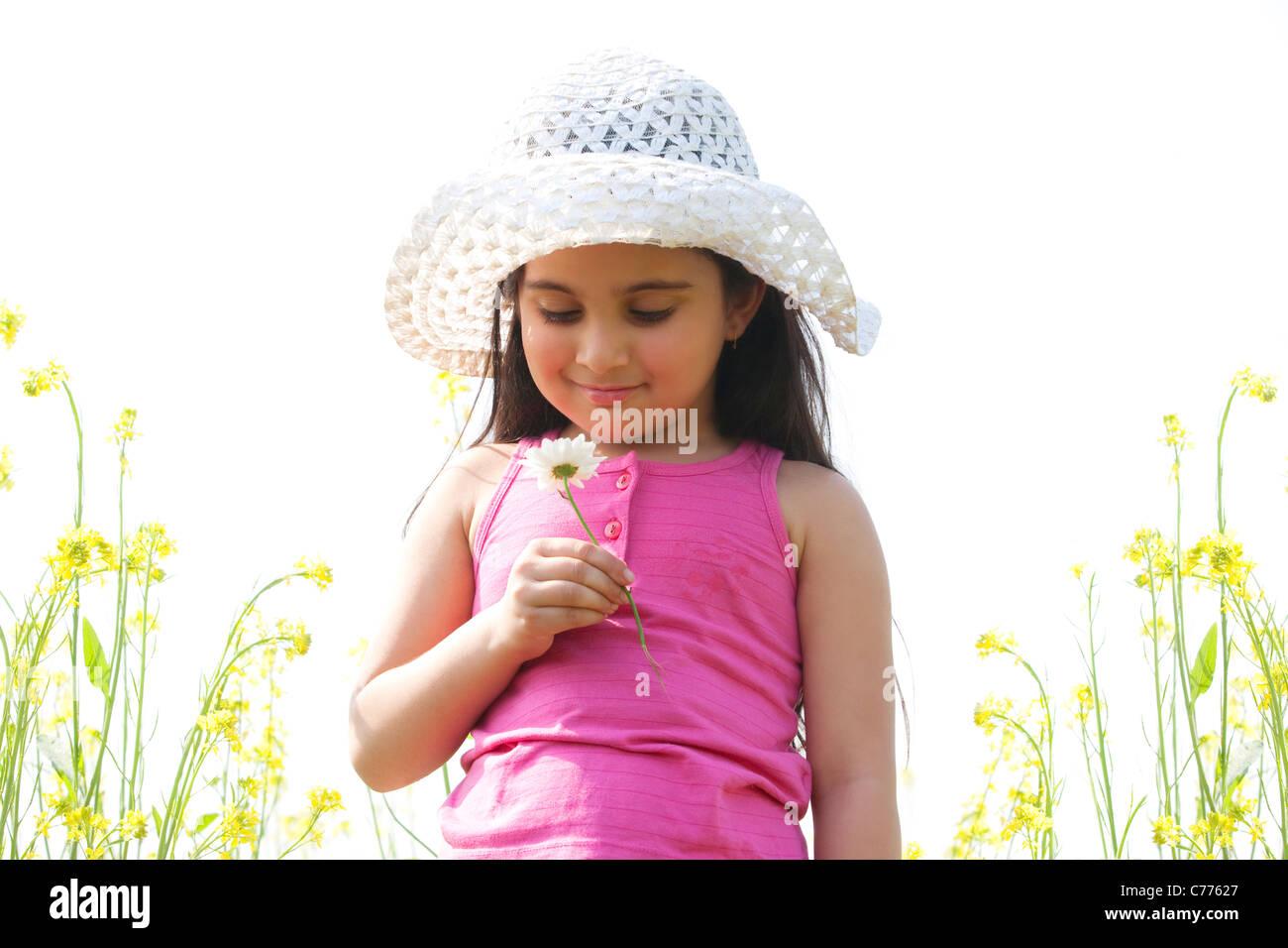 Giovane ragazza con un fiore Immagini Stock