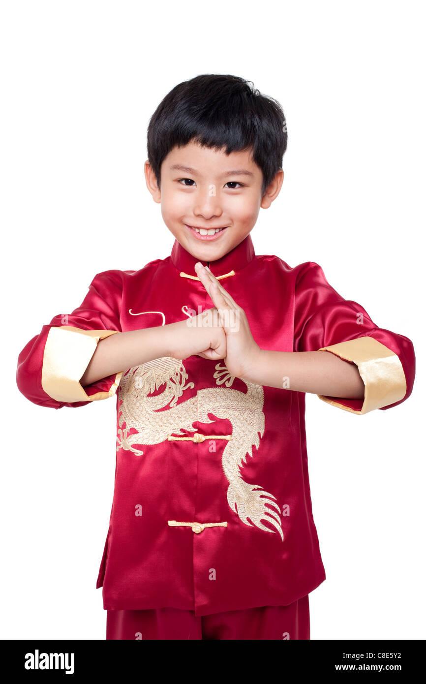 Ragazzo giovane vestito in cinese tradizionale abbigliamento Immagini Stock